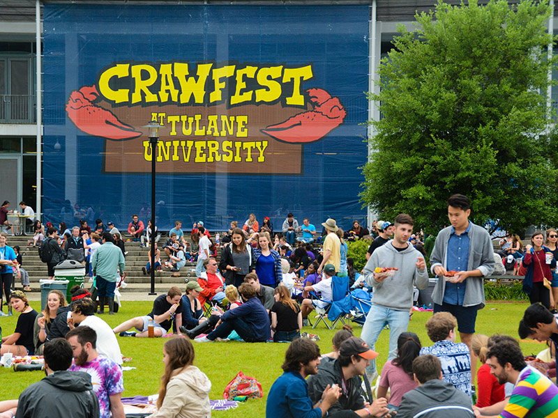 Students sit in the LBC quad for Crawfest