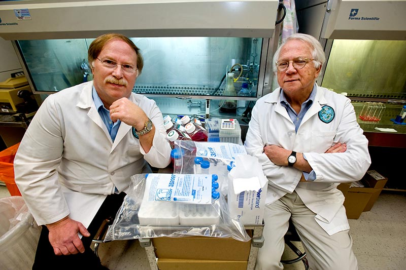 Robert Garry (left) and Dr. James Robinson in their lab