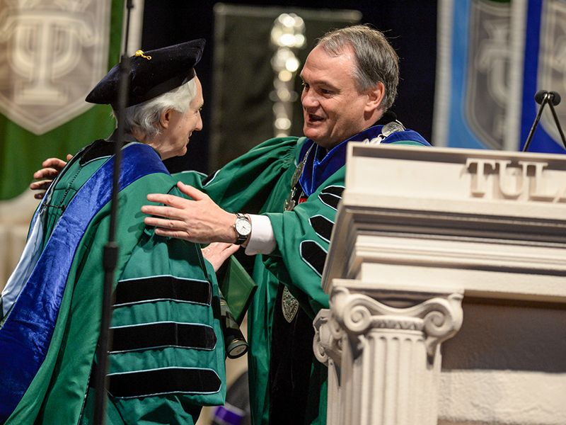 President Fitts congratulates an honorary degree recipient at a past Unified Commencement Ceremony
